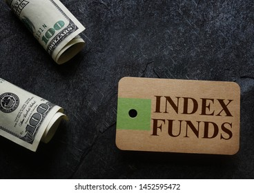 Index Funds tag with cash on dark background