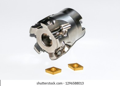 An indexable milling cutter for CNC milling machine with two carbide inserts with selective focus isolated on white