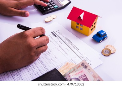India and accounting concept showing accountant working on Income tax forms with currency notes, calculator and house/car 3d Models