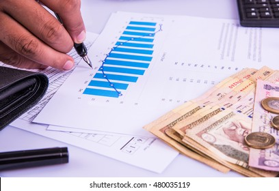 India and accounting concept showing accountant working on Income tax forms or on budget planning with currency notes, calculator and house/car 3d Models