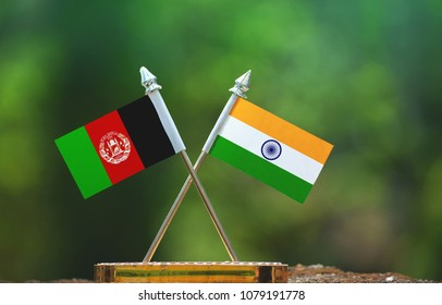 India and Afghanistan small flag with blur green background