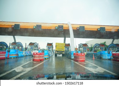 india - agra - yamuna expressway - september 9, 2019 truck stands in a toll plaza in a rainy day, a truck stops to pay the toll in a rainy day