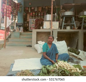 India, Anantapur - February 1, 2016: Little shop of spices and street vendor of vegetables