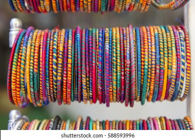 india art style colorful bangles in hanging display front shop