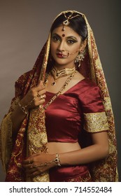India bride with bridal make-up, jewelry and ethnic wedding dress
