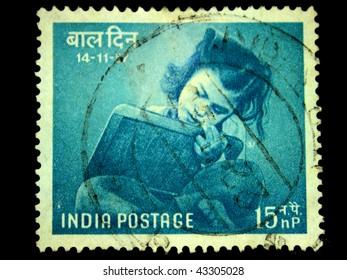 INDIA - CIRCA 1958:  A Stamp printed in India shows girl reading book, circa 1958