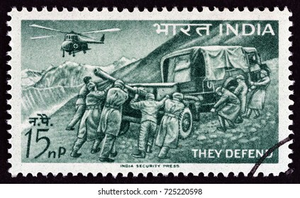 "INDIA - CIRCA 1963: A stamp printed in India from the ""Defense Campaign"" issue shows soldiers, Field artillery and helicopter, circa 1963."
