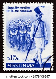 INDIA - CIRCA 1967: A stamp printed in India issued for the 4th anniversary of Nagaland as a State of India shows Nehru leading Naga Tribesmen, circa 1967.