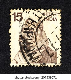 INDIA - CIRCA 1974: Brown color postage stamp printed in India with image of a Bengal Tiger.