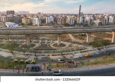 India cityscape aerial view with city architecture buildings and over bridge under construction with adjoining city roads at sunset. Photograph shot at Newtown area of Kolkata India