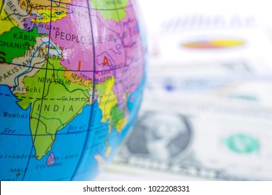 India close up Globe world map on US dollar banknote money chart graph. Finance, Account, Statistics, Investment, Analytic research data economy and Business company meeting concept.