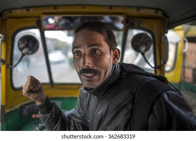 INDIA - December 2014: Indian auto rickshaw with taxi driver man in agra India