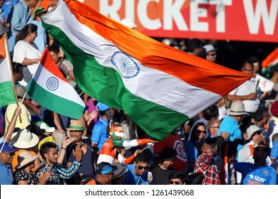 India fans wave their national flags during the Pool B Cricket World Cup match between India and Ireland at Sedden Park in Hamilton on March 10, 2015.AFP PHOTO / Michael Bradley