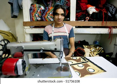 INDIA - FEB 26: Young textile worker in a small factory in Old Delh on February 26, 2008 in Delhi, India. Working age in this factory is from 16 to 71 years old.