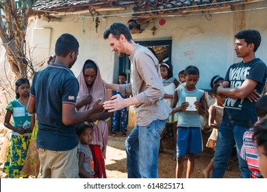 India - February 10, 2015: Missionary prays for woman in the village