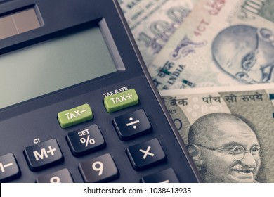 India financial, new emerging market high growth country concept, closed up of calculator on indian rupee banknotes on table.
