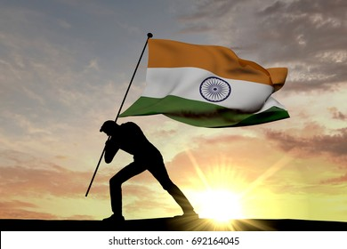 India flag being pushed into the ground by a male silhouette. 3D Rendering