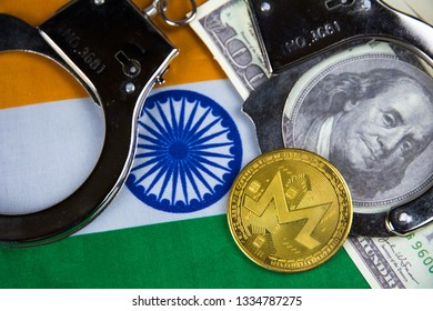India flag with handcuffs and a bundle of dollars and monero coin. Currency corruption in the country. Financial crimes