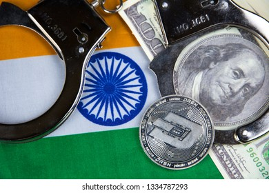 India flag with handcuffs and a bundle of dollars and dash coin. Currency corruption in the country. Financial crimes