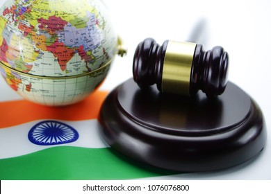 India flag and Judge hammer with globe world map. Law and justice court concept.