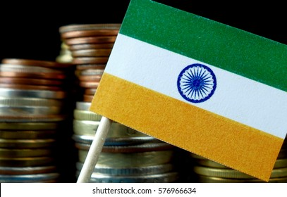 India flag waving with stack of money coins macro