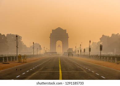 India Gate, Delhi, January-2019:  Silhouette of triumphal arch style war memorial during smoggy winter morning. Due to cold & stagnant winds fog form and traps pollutant thus pollution level rises.
