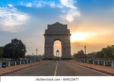 India Gate Delhi at sunrise with a vibrant moody sky. The India Gate, is a war memorial located on the east side of Rajpath road and an important city landmark.