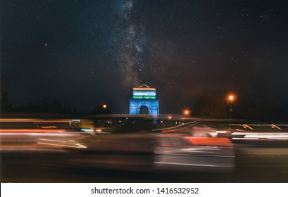 India gate during night with milky way and traffic. Composition of two images.