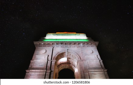 India gate illuminated with Tricolor (Indian Flag) at night with stars.