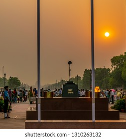 India Gate, New Delhi, India; 26-Apr-2018; The Flame of the immortal soldier (Amar Jawan Jyoti) and the guard in the backdrop of the setting sun