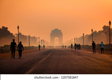 India Gate, New Delhi, October-2018:  Silhouette of triumphal arch architectural style war memorial during hazy morning. Pollution level rises and causes smog in autumn season due stagnant winds.