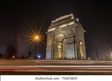 india gate at night with high speed lights, new delhi, india