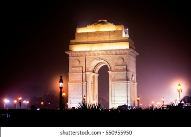 India gate at night with multicolored lights. This landmark is one of the main attractions of Delhi and a popular tourist destination. It was designed by Edwin Luytens
