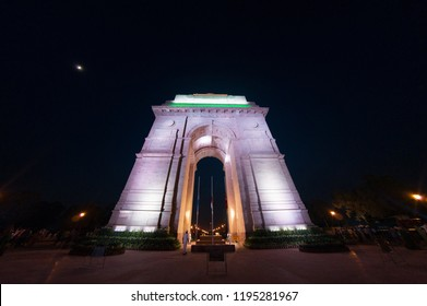 India gate shot at night with a wide eye fisheye lens. With the lights on this famous landmark makes this a perfect place for people to gather and enjoy