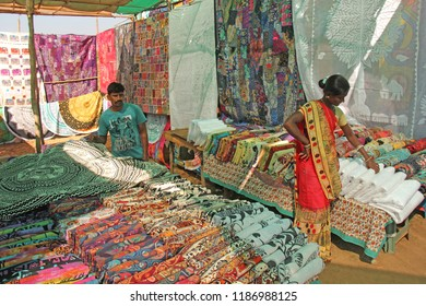 India, GOA, January 24, 2018. Indian market in the village of Anjuna. Bright goods and paints of India. Sellers sell their products on the market.