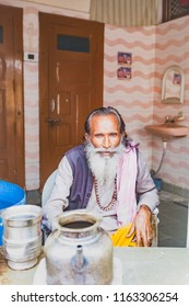 India, Govardhan, October 2016 :bearded indian old man  distributes water