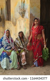 India, Govardhana, November 2016:women in national clothes posing near an old house in india town of Govardhan