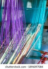 India Handloom Board. Loom of weaving Colored threads.
