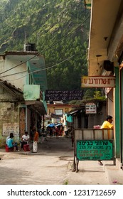 India, Himachal Pradesh, Kasol, 08/14/2010: a street of the village of kasol (little israel) in the Parvati valley with shop signs written in Hebrew language