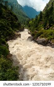 India, Himachal Pradesh, Kasol, 08/15/2010: Parvati river from a bridge in the village of Kasol