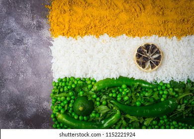 India Independence Day 15 August concept: Indian National Flag tricolor from vegetables. Top view. Gray background. Copy space left.