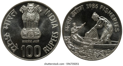 India Indian silver coin 100 one hundred rupees 1986, lions on chapiter with lotus flower, two fishermen in boat one with paddle the other with net, fish in net,