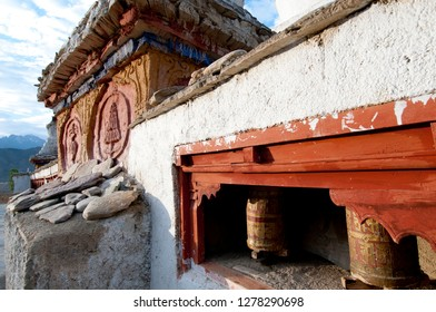 India, Jammu & Kashmir, Ladakh, Lamayuru on the Srinagar-Kargil-Leh road prayer wheels and a decorated chorten.