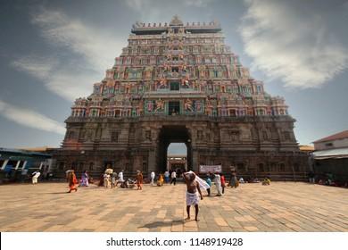 India Kanchipuram January 10, 2018: Pilgrims walk near the front gate of the temple