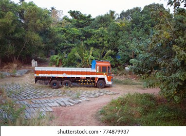 India, Kerala- January 11, 2016: Indian red truck in area around house, manufacturer of paving slabs
