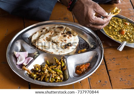 India local food, Traditional Indian bread chapati with curries