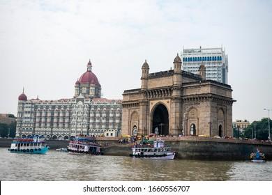 India, Mumbai - December 22 2019 - Gateway of India and Taj Mahal Palace hotel seen from the boat