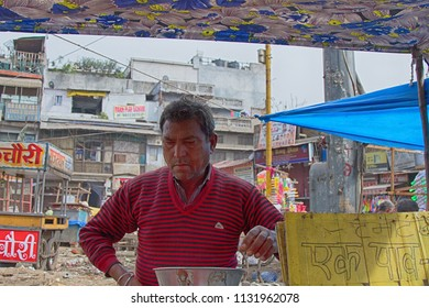 India, new Delhi - March 1, 2018: Eateries among the littered area and food seller