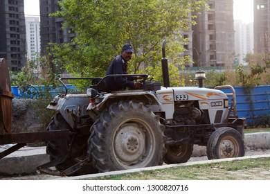 India, new Delhi - March 1, 2018: minitractor and Tractor driver in a special uniform