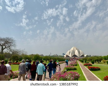 INDIA, NEW DELHI - MARCH 20, 2019: Worshippers visiting the Bahá'í House of Worship, better known as the Lotus Temple, a non-denomination house of worship.